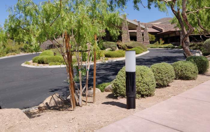 NxT solar bollard pathway lighting at parking lot.