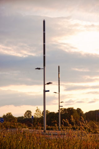Soluxio hybrid solar light sustainable solar light poles at energy neutral roundabout with vertical solar panels and modular design