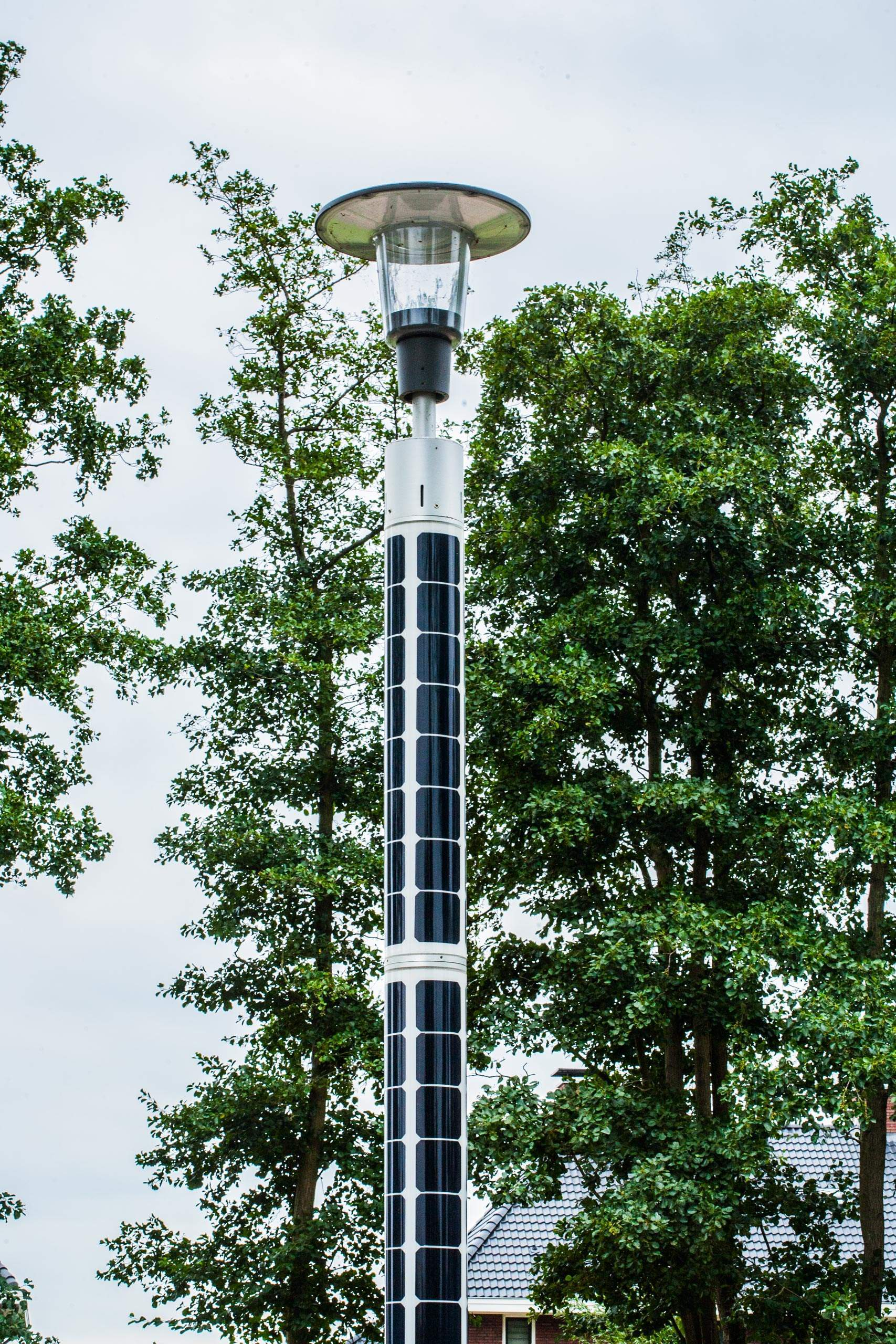 Soluxio solar landscape lighting in green city with two cylindrical solar modules and Philips led light