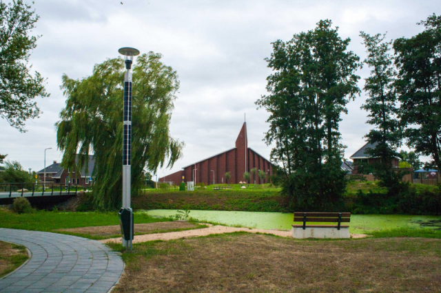 Soluxio solar landscape lighting in park with bench and a view