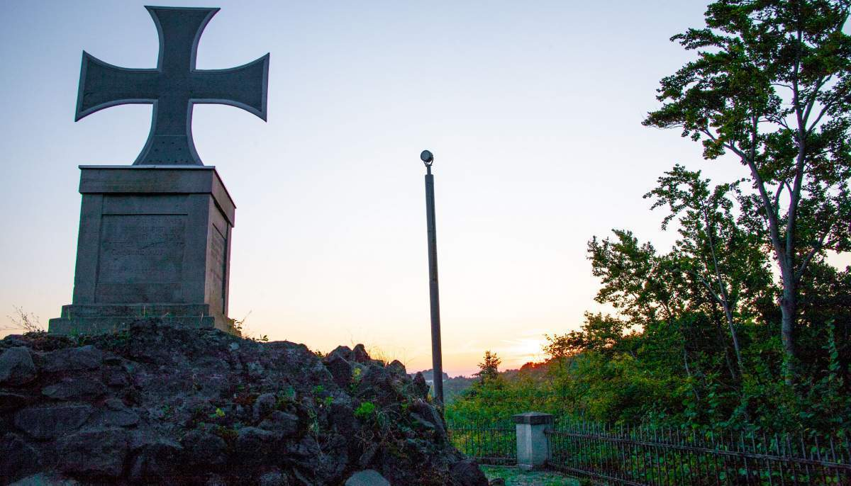Solar powered monument lighting pole at sunset