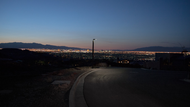 Soluxio solar pathway lighting during night with view on smart city Las Vegas